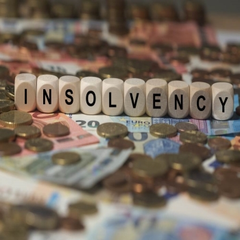 How do insolvency laws differ in England vs Scotland?